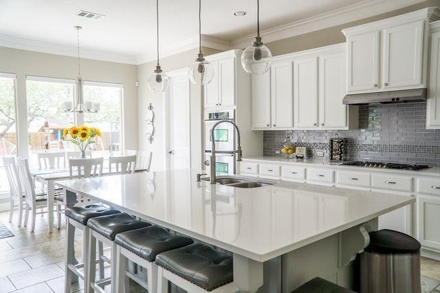 Alt: White kitchen and dining area